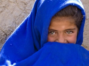 Afghan girl in blue scarf smiling